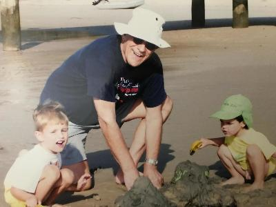 Playing on the beach with grandchildren Christopher and Marcus